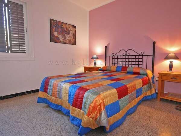 купить квартиру в Кала Каньелес Льорет-де-Мар спальня